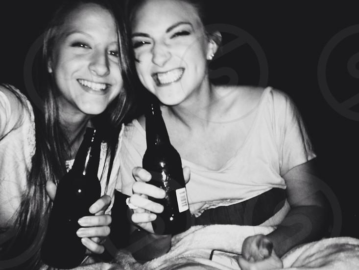women holding glass bottle photo