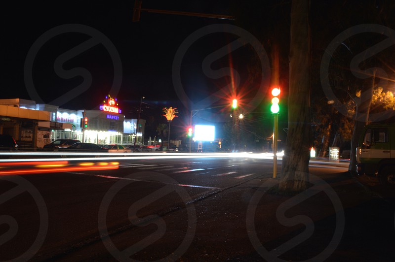 stoplights lighted near mid rise buildings during night time photo