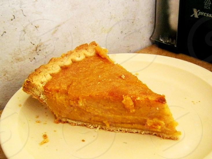 Sweet potato pie slice on beige plate photo