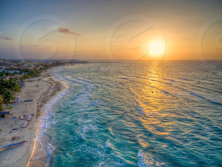 birds eye view photography of a beach during sunset photo