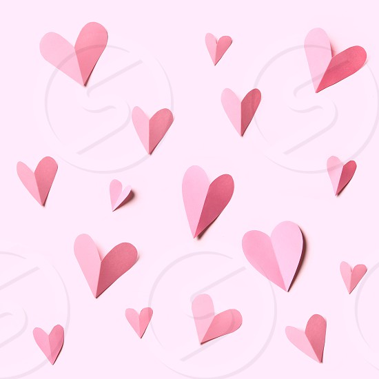 Holiday Card. Heart made of pink papers isolated on white background. Texture for decoration of post card. photo