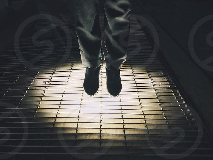 man standing wearing black shoes photo