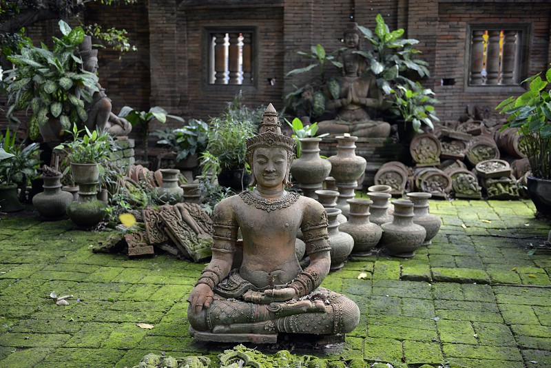 a garden and Buddha terracota of Mr Ban Phor Linag Meuns Terracota Art in the city of chiang mai in the north of Thailand in Southeastasia. 