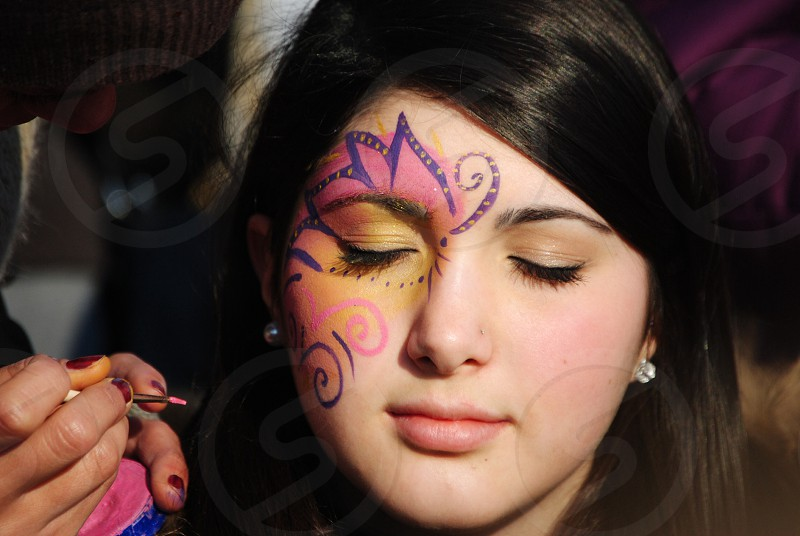 girl with face paint photo