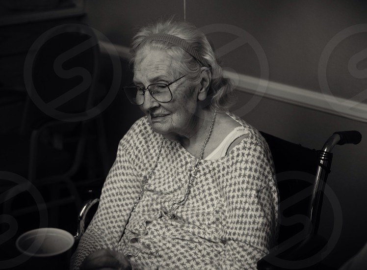 woman in silver framed eyeglasses sitting on wheelchair photo