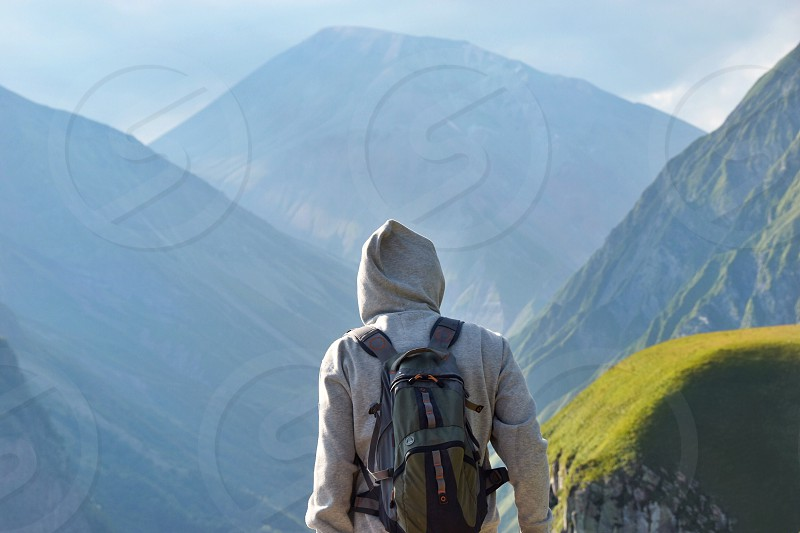 Man looking at the mountains  photo