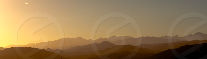 Layers of the Rocky Mountains at dusk viewed from near Boulder Colorado. photo