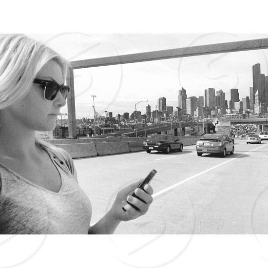 Blonde Woman Standing in Traffic photo
