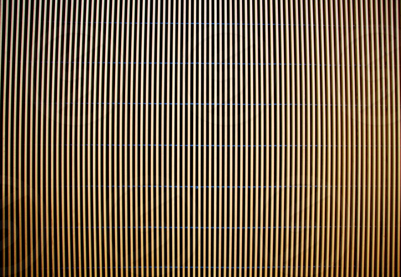 Wooden slats in a museum wall cause an optical illusion and seem to move. photo