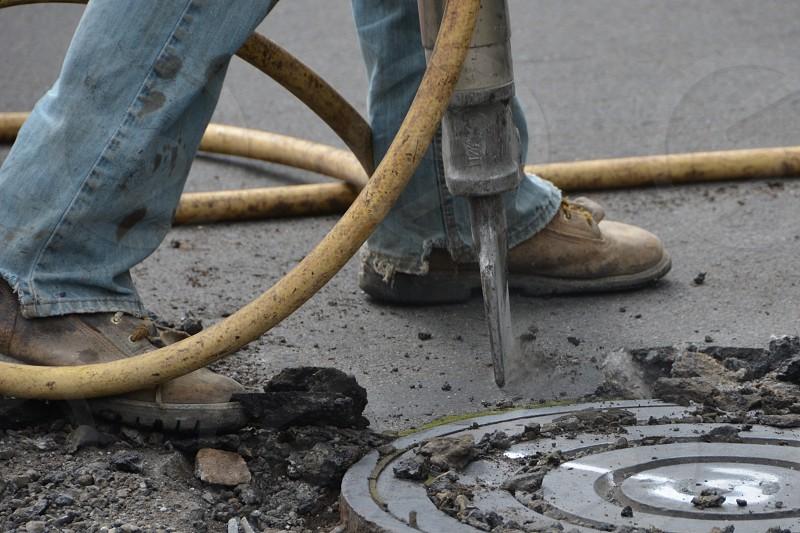 Jackhammer manhole work boots jeans man  photo