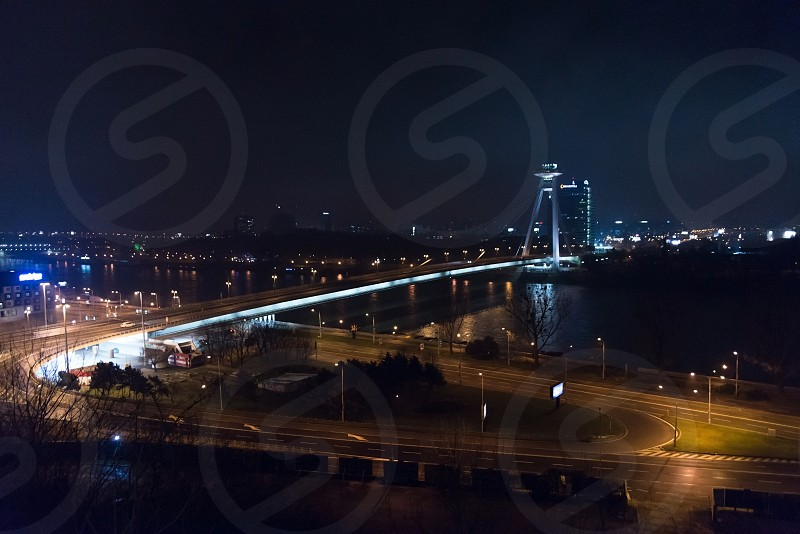 Night auto traffic with cars and buses in Bratislava Slovakia photo