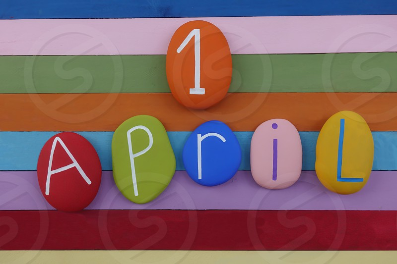 1 April fool day scomposed with colored stones over a multi colored wooden board  photo