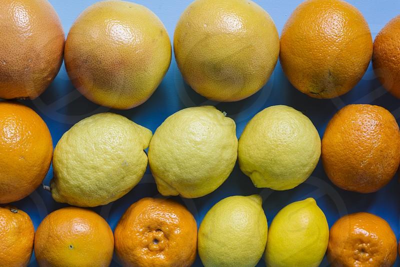citrus fruit food grapefruits lemon orange mandarin pattern backgrounds photo
