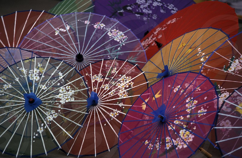 umbrellas for sale at the town of Yangshou near the city of  Guilin in the Province of Guangxi in china in east asia.  photo
