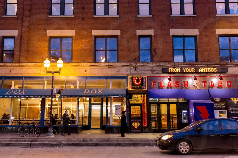 Wicker Park neighborhood in Chicago IL. Strip of restaurants on Damen Ave photo