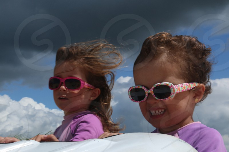 boy and a girl using sunglasses photo