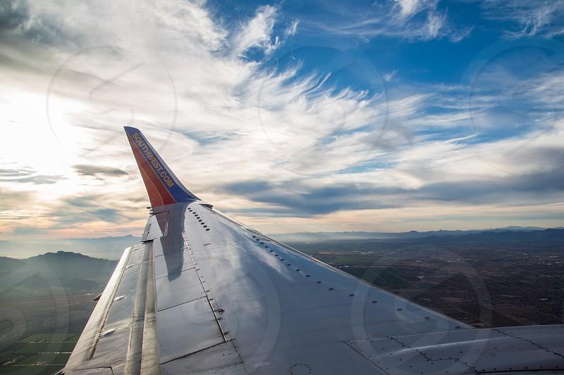 white orange and blue southwest.com passenger plane photo