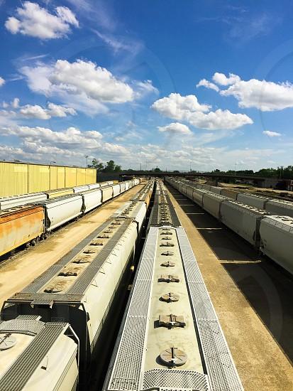 Trains tracks Illinois small townstravel summer heat choo choo cars cargo bridgeperspective  photo