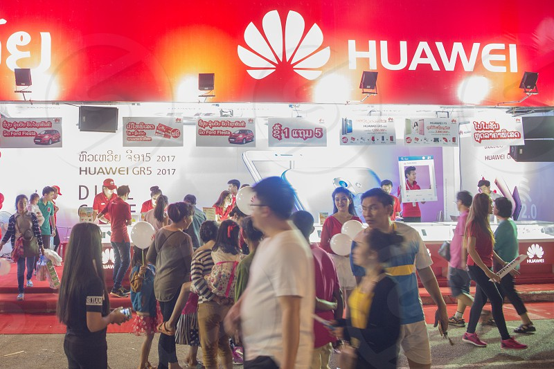 a huawei phne shop shop at the market at the Pha That Luang Festival in the city of vientiane in Laos in the southeastasia. photo