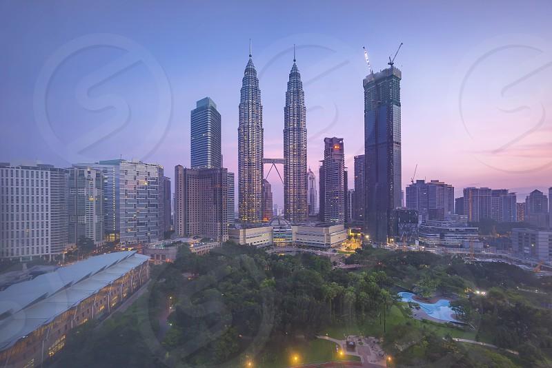 Beautiful sunrise sky over Kuala Lumpur City Skyline photo