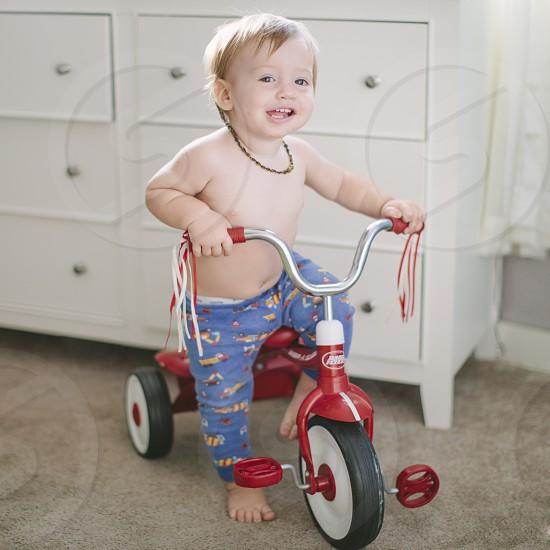 boy in red trike photo