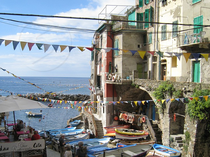 Flags over Cinque Terre seaside town photo