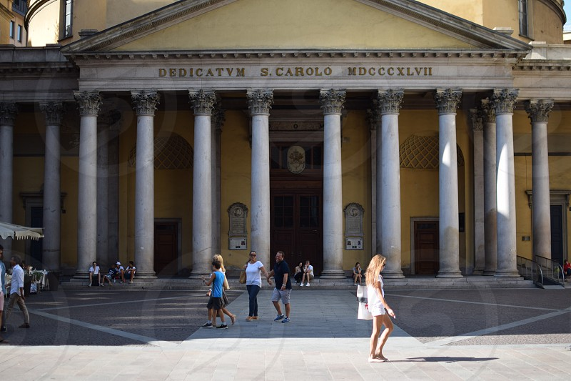 people walking in front of Dedicatym S.Carolo MDCCCXLVII building during day time photo