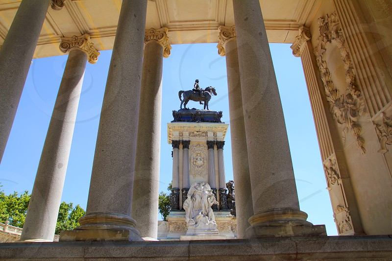Alfonso XII monument Madrid in Retiro park near lake photo