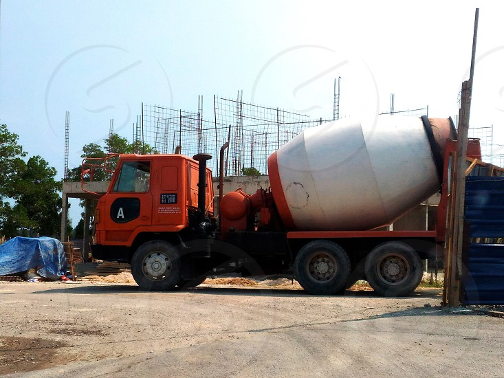grey and red mixer truck on construction site during daytime photo