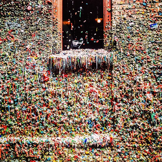 Gum wall seattle gum wall window sticky vibrant color hidden gem odd different weird gross germ slimy slim ally theater washington Pacific Northwest northwest photo