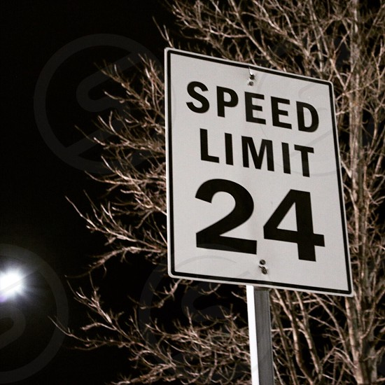 Speed Limit 24 street signage photo