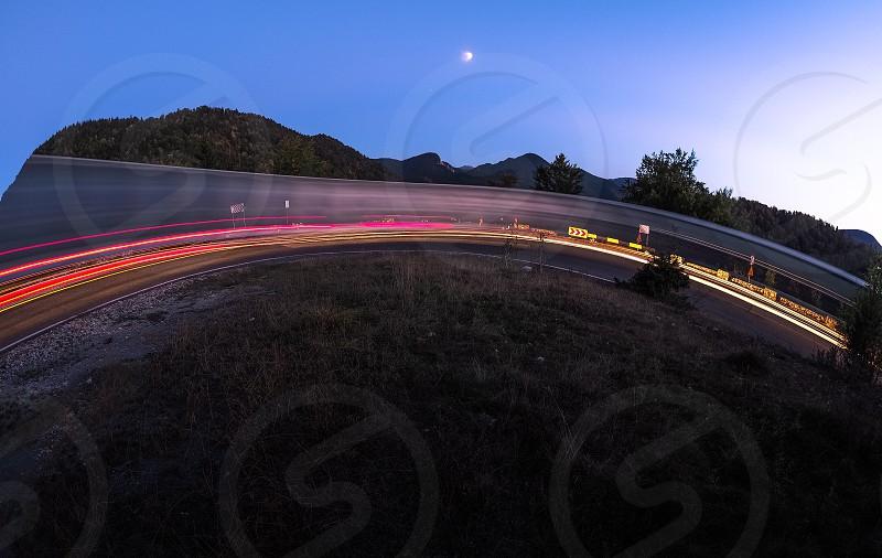 curvelightstrailsroadnightmoonspeedround photo