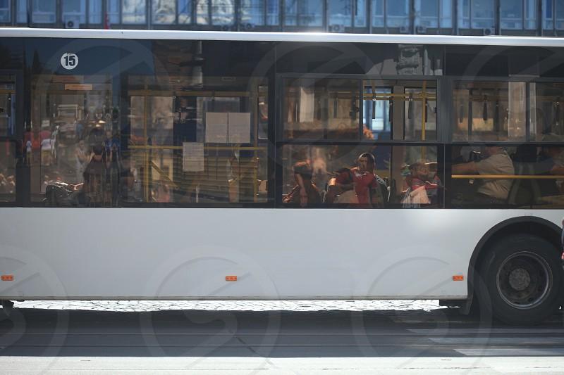 white bus stop on pedestrian lane photo
