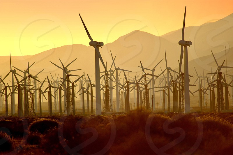 Wind windmills turbine energy mountains sunset haze desert red smoke fire air orange yellow power energy environment environmental climate change climate  photo