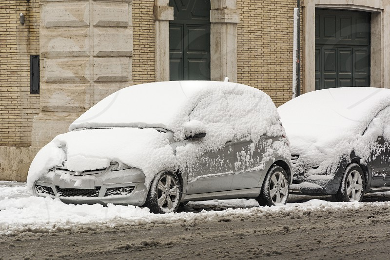 parked cars covered with snow. Winter and cold temperatures concept photo