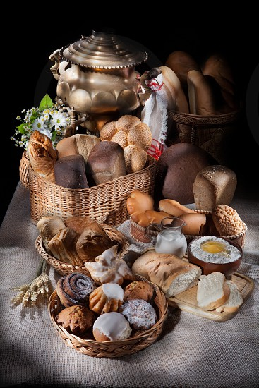 Still Life With Bread Pastry nd Wicker Basket photo