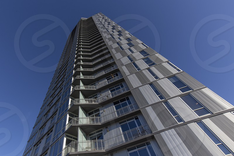 Confluence apartments soaring into blue sky photo