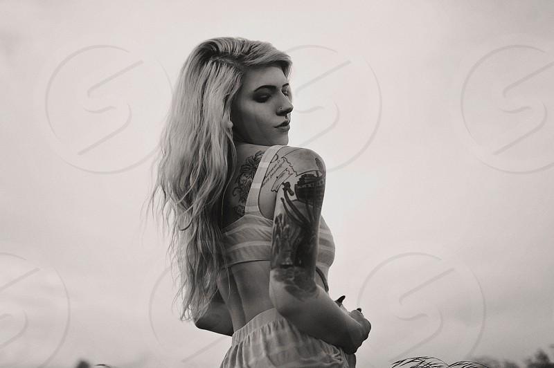 black and white photo of woman wearing bra photo