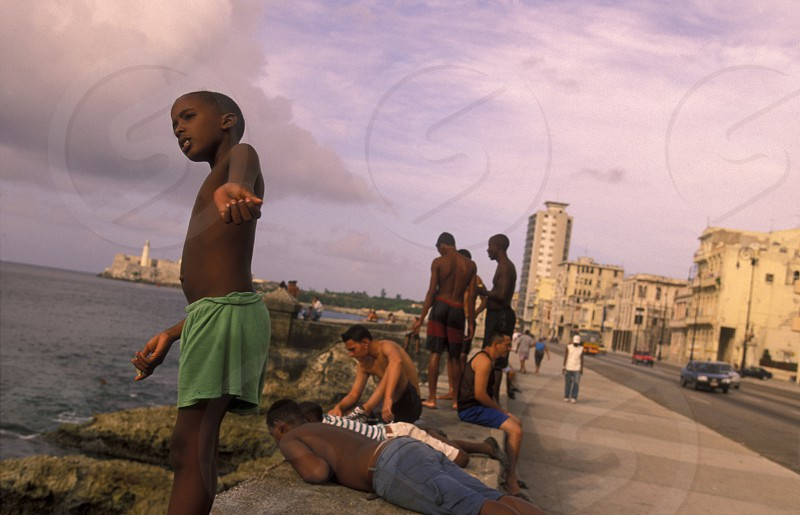 the Malecon road on the coast in the old townl of the city of Havana on Cuba in the caribbean sea photo