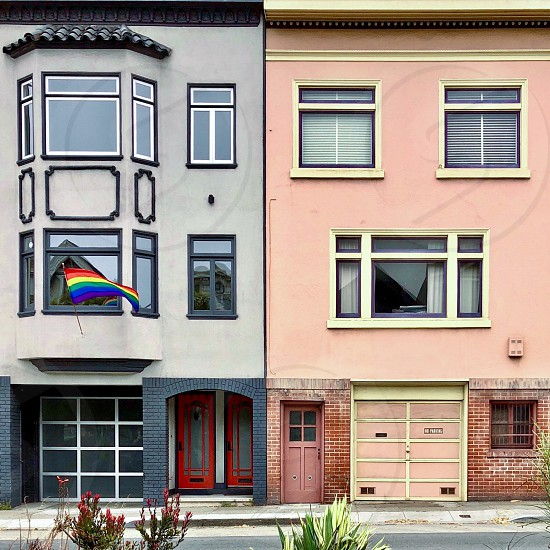 Building facades rainbow flag photo