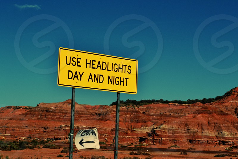Use Headlights Day and Night Roadsign Sign Yellow photo