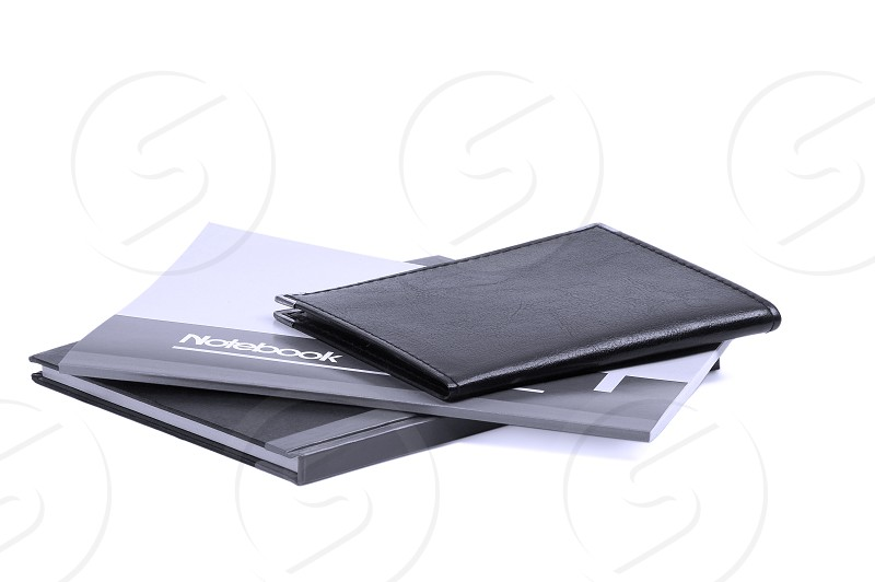 assorted notebooks flat piled on white backgroundblue filter photo