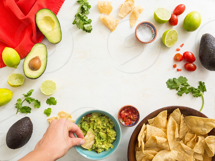 Tortilla chips and guacamole photo