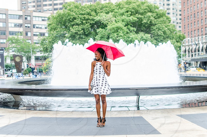 polka dots red umbrella woman smiling smiling fountain water chic photo