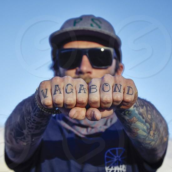 Vagabond freedom camping rebel tattoos hard tough 20s man photo