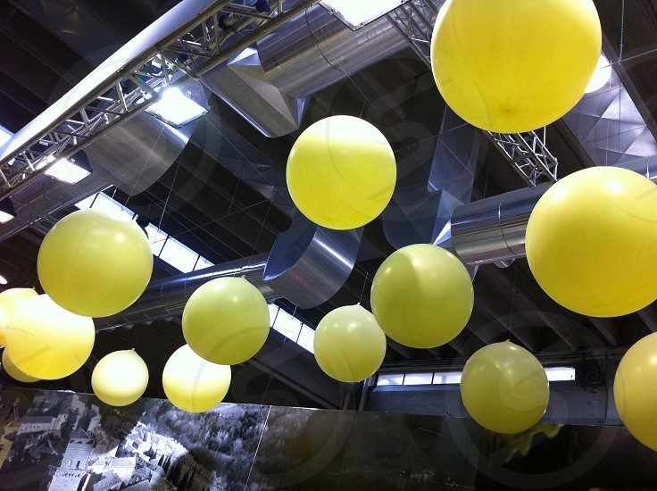 yellow balloon and ceiling single color focus photography photo
