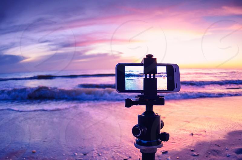 An iphone capturing an amazing beach sunset. photo