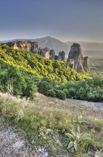 Panoramic view of the Rousanou Monastery in Meteora Kalambaka town in Greece on a sunny summer evening photo