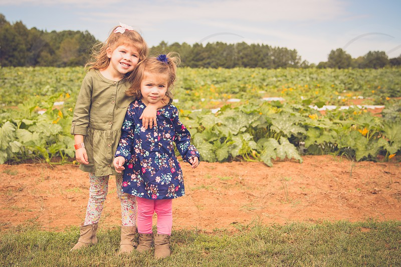 Toddlers in a Pumpkin Patch photo