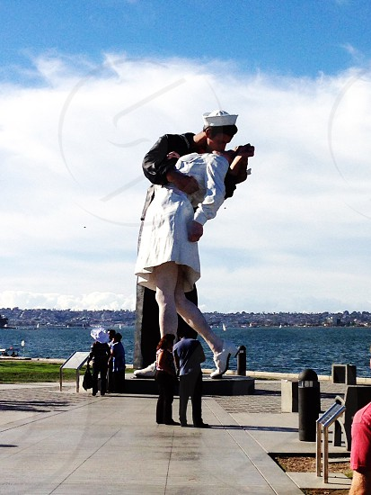 woman kissing the woman statue photo